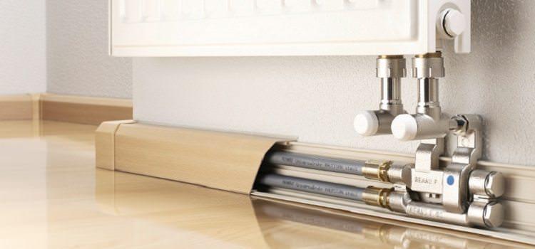 Как спрятать стояки отопления в квартире
